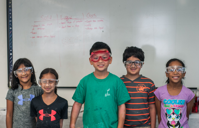 Chemistry Concepts class photo; these kids know their solids, liquids, and gases!