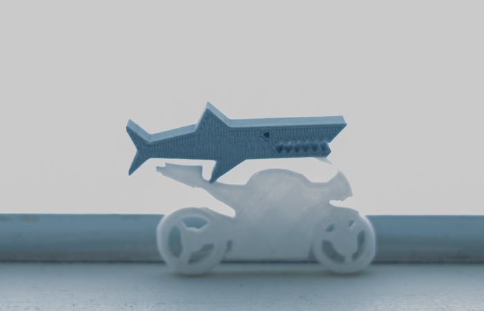 A 3D-printed shark riding a 3D printed bicycle!