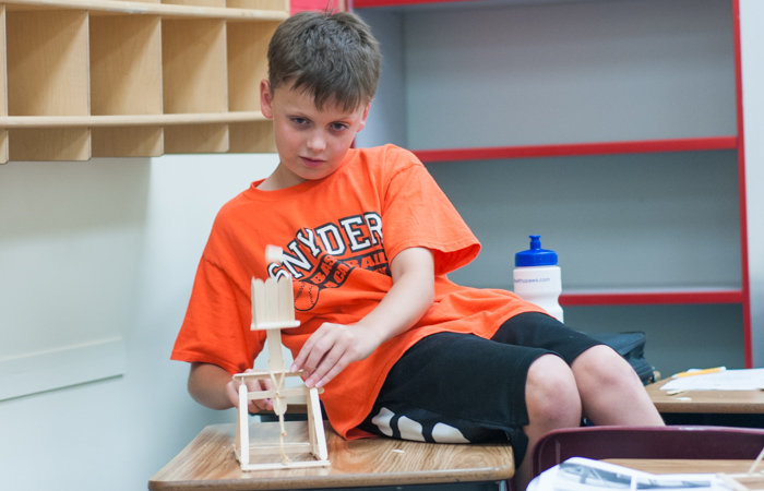 A student tests out his finished project.