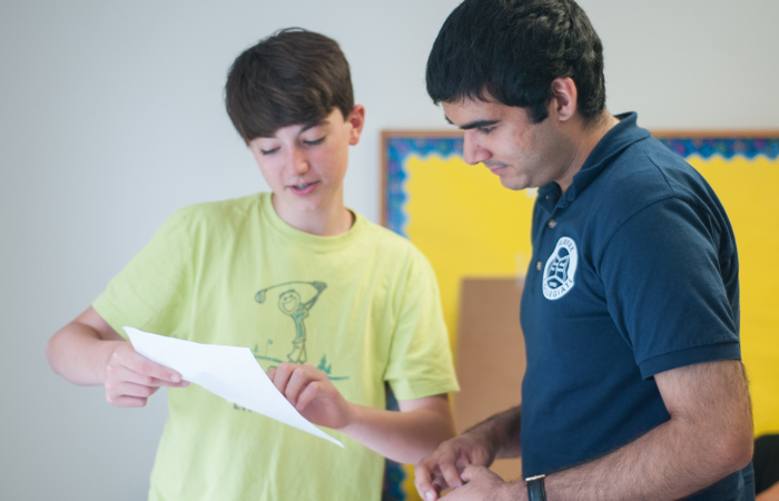 Instructor checks his student's work.