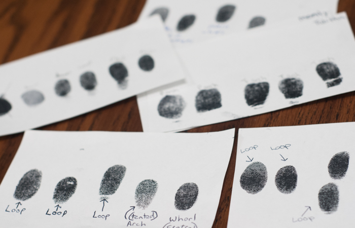 Students learn to fingerprint and identify unique aspects of each print.