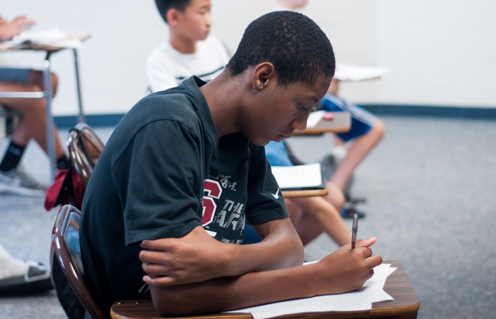 A student works on an essay.