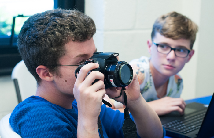 A student experiments with a DSLR.