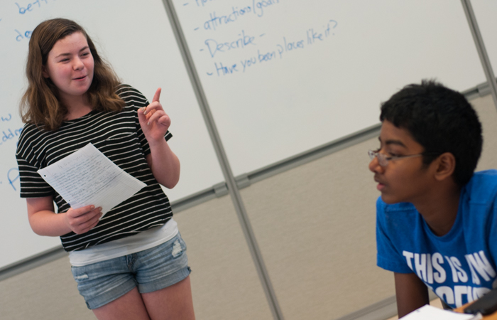 A student enthusiastically delivers her rebuttal.