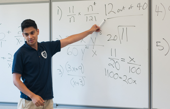 An instructor explains equations.