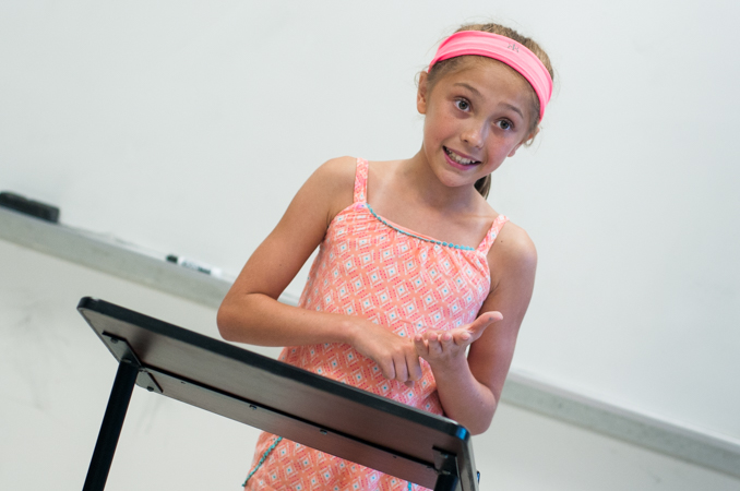A student gives a persuasive speech in front of the class.