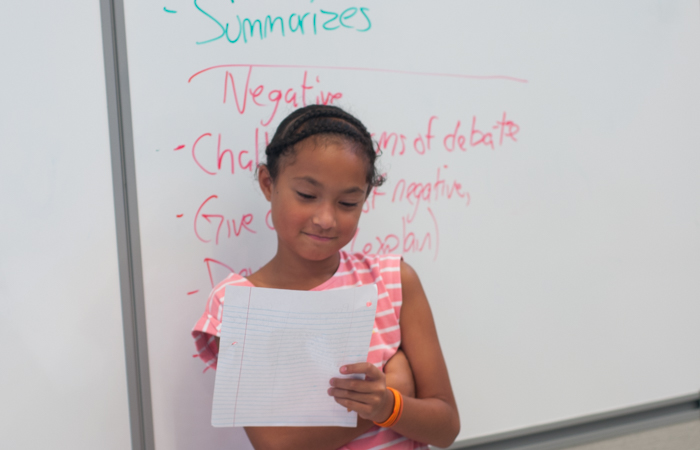 A student prepares to deliver her speech.