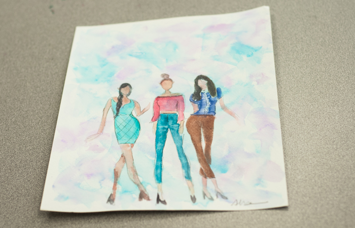 Students first practice fashion illustration on paper.