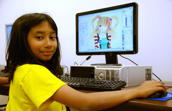 A student with her digital illustration.