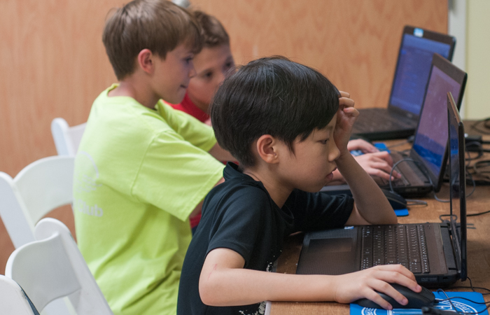 Minecraft students absorbed in their modding.